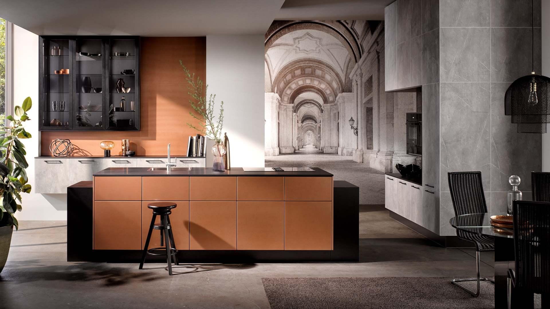Häcker Küche | Grauer Marmor mit Kupferfronten - Küchentrends 2021